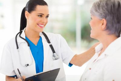 nurse smiling to senior woman
