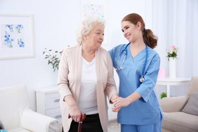 nurse helping a senior woman