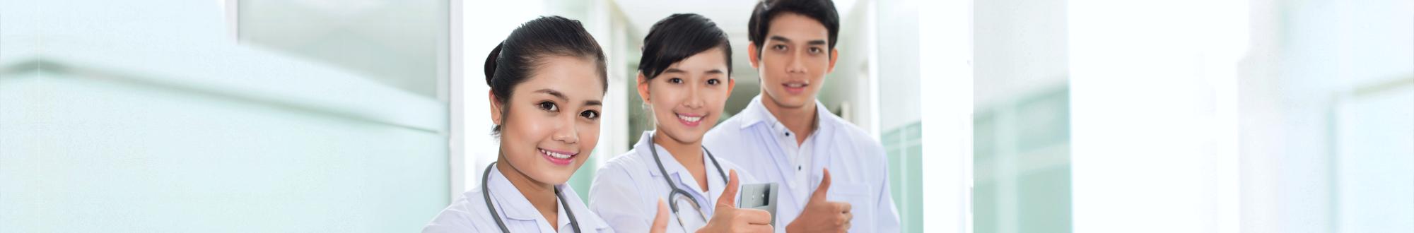 nurses smiling at camera